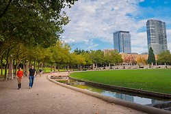 North America, United States, Washington, Bellevue. People strolling around Downtown Park in the autumn.