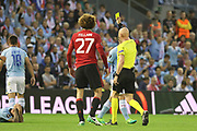 Marouane Fellaini Midfielder of Manchester United shown yellow card during the Europa League semi final game 1 match between Celta Vigo and Manchester United at Balaidos, Vigo, Spain on 4 May 2017. Photo by Phil Duncan.