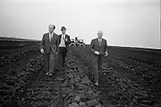23/09/1963<br /> 09/23/1963<br /> 23 September 1963<br /> Minister sees advances in peat productivity by Bord na Mona. Picture shows the Minister for Transport and Power, Mr Erskine Childers (left) inspecting theTimahoe turf works, during his end of season visit to Bord na Mona installations. Also in the picture are Mr Dermot Lawlor, (right) Managing Director, Bord na Mona and Mr Eugene Redehan, (centre) Chief Civil Engineer, Bord na Mona.