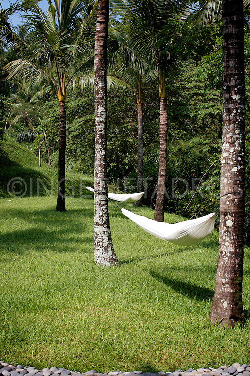 Hammocks around the luxury pool in Hotel Komaneka , the soul of Bali in the heart of Ubud.<br />