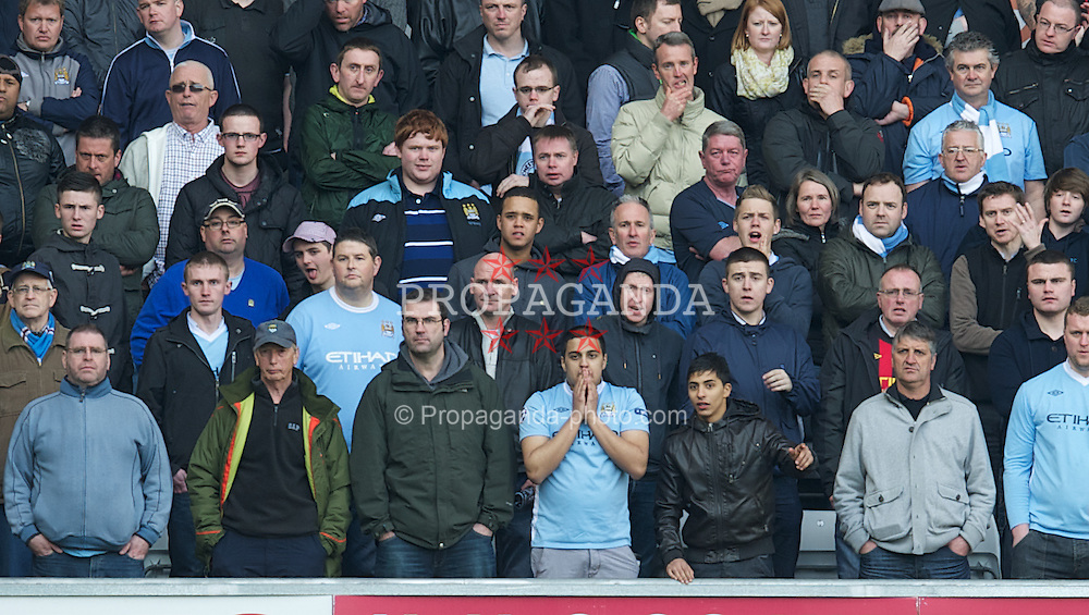 SWANSEA, WALES - Sunday, March 11, 2012: A Manchester City supporter looks dejected as his side lose 1-0 to Swansea City during the Premiership match at the Liberty Stadium. (Pic by David Rawcliffe/Propaganda)
