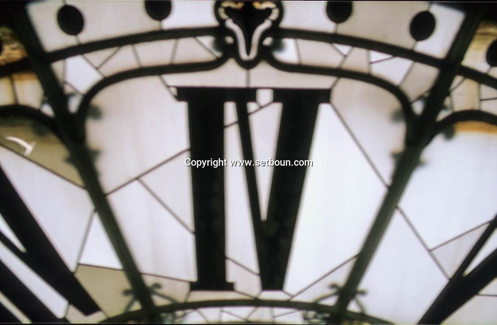 France. Paris. Man Adjusting Clock of Hotel de Ville