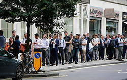 © Licensed to London News Pictures. 26/07/2016. London, UK. Members of the public queue ahead of a rally by Labour leadership candidate Owen Smith at Emmanuel Centre in London on 26 July 2016. Photo credit: Tolga Akmen/LNP