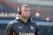 Wolverhampton Wanderers defender Dominic Iorfa (18) arrives at the City Ground wearing Beats headphones ahead of the Sky Bet Championship match between Nottingham Forest and Wolverhampton Wanderers at the City Ground, Nottingham, England on 30 April 2016. Photo by Jon Hobley.