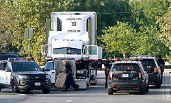 July 23, 2017 - San Antonio, TEXAS, USA - Law enforcement at the scene, where people were discovered inside a tractor trailer in a Walmart parking lot at IH35 South and Palo Alto Road, Sunday, July 23, 2017. Reports say that 8 were dead and several were in critical condition. (Credit Image: © San Antonio Express-News via ZUMA Wire)