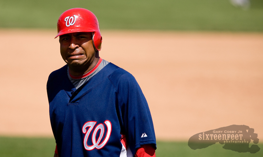 Photo by Gary Cosby Jr.  The Washington Nationals defeated the Baltimore Orioles in a spring training game 5-4, Thursday, March 19, 2009, in Viera, FL.  Nationals' Jose Castillo grimaces after legging out an infield hit.