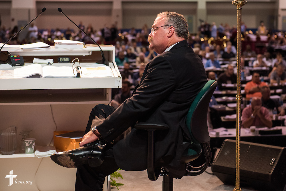 The Rev. Dr. Matthew C. Harrison, president of the LCMS, listens to the Rev. Dr. Roosevelt Gray Jr., during his essay on Monday, July 11, 2016, at the 66th Regular Convention of The Lutheran Church–Missouri Synod, in Milwaukee. LCMS/Frank Kohn
