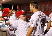 Friday, Aug. 17, 2012  REDS SPORTS : Cincinnati Reds guest bat boy Ted Kremer of White Oak was enjoying himself along with Chirs Heisey in the dugout during their baseball game against the Chicago Cubs at Great American Ball Park.  The Enquirer/Jeff Swinger