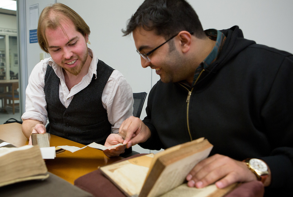 Ohio University students Galem Miller-Atkins, left, and Ahmad Alhammouri examine ancient math texts during a special presentation at Alden Library on April 18, 2014. During the presentation, students enrolled in Associate Professor Bob Klein's History of Mathematics class viewed centuries-old math manuscripts from the library's Special Collections section. Photo by Lauren Pond