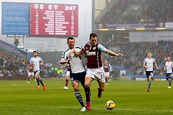 Burnley's Ashley Barnes and West Brom's Gareth McAuley - Photo mandatory by-line: Matt McNulty/JMP - Mobile: 07966 386802 - 08/02/2015 - SPORT - Football - Burnley - Turf Moor - Burnley v West Brom - Barclays Premier League