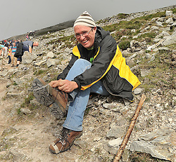 Running Repairs....Padraig Food from Edgeworthstown Co Longford performs some DIY repairs on his boots during his way up to the summit of Croagh Patrick yesterday.<br /> Pic Conor McKeown