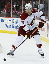 Mar 12, 2009; Newark, NJ, USA; Phoenix Coyotes right wing Shane Doan (19) skates with the puck during the first period at the Prudential Center.