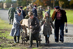 Pickering 1940s war weekend Northern World War Two Association Battle Re-enactment. Association members portray refugees streaming back through German lines away from the expected battle. October 2009 Image Copyright Paul David Drabble