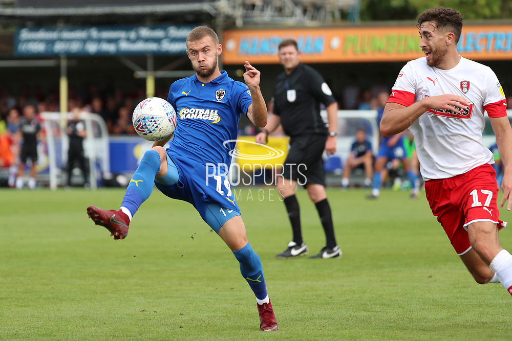 AFC Wimbledon attacker Shane McLoughlin (19) dribbling during the EFL Sky Bet League 1 match between AFC Wimbledon and Rotherham United at the Cherry Red Records Stadium, Kingston, England on 3 August 2019.