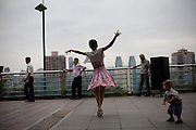 A woman dances in a public square in Qongqing China.