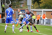 Colchester Utd defender Kane Vincent-Young and Morecambe FC forward Tom Barkhuizen (9) tussle by the touchline during the EFL Sky Bet League 2 match between Colchester United and Morecambe at the Weston Homes Community Stadium, Colchester, England on 22 October 2016. Photo by Nigel Cole.