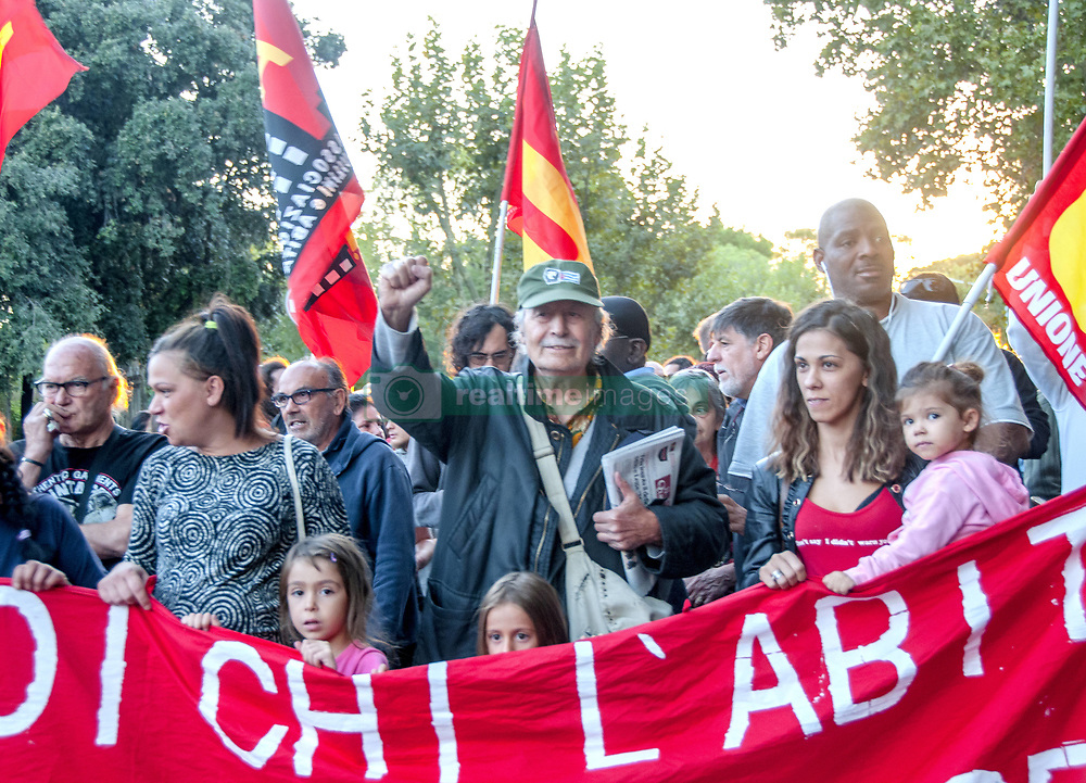 September 28, 2018 - Rome, Italy, Italy - Demonstration against eviction today in Rome and against after the arrest of four people, (which two representing of the basic union USB and two of neighborhood committee), that together with other activists and  residents of the neighborhood they rushed into defense of a woman, Annamaria, 66, that was about to be evicted from his home. The woman was climbing over the balcony railing and threatening to throw herself . Firefighters intervened. The municipal police who carried out the eviction also used pepper spray against protesters, and one activist had to resort to health care. Anche Annamaria, retired, that she perceives 500 euros a month, was present at the demonstration (Credit Image: © Patrizia Cortellessa/Pacific Press via ZUMA Wire)