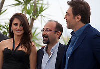 Penelope Cruz, Director Asghar Farhadi and Javier Bardem at the Everybody Knows film photo call at the 71st Cannes Film Festival, Wednesday 9th May 2018, Cannes, France. Photo credit: Doreen Kennedy