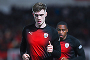 Liam Lindsay of Barnsley (6) warming up during the EFL Sky Bet League 1 match between Doncaster Rovers and Barnsley at the Keepmoat Stadium, Doncaster, England on 15 March 2019.