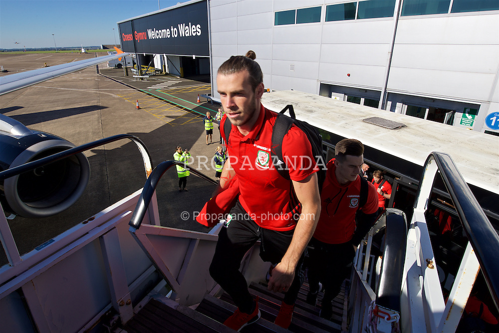 CARDIFF, WALES - Wednesday, October 5, 2016: Wales' Gareth Bale boards the team plane at Cardiff Airport as the team travel to Vienna ahead of the 2018 FIFA World Cup Qualifying Group D match against Austria. (Pic by David Rawcliffe/Propaganda)