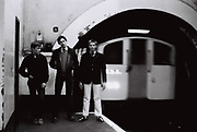 Teenagers recreate the sleeve for 'Down in the Tube Station at Midnight' by The Jam, London, UK, 1980s.