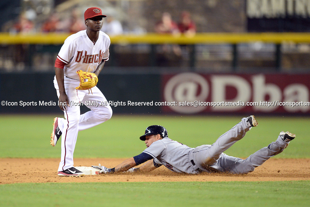 Jun 24, 2014; Cleveland Indians shortstop Asdrubal Cabrera (13) steals second base in the ninth inning against the Arizona Diamondbacks at Chase Field.