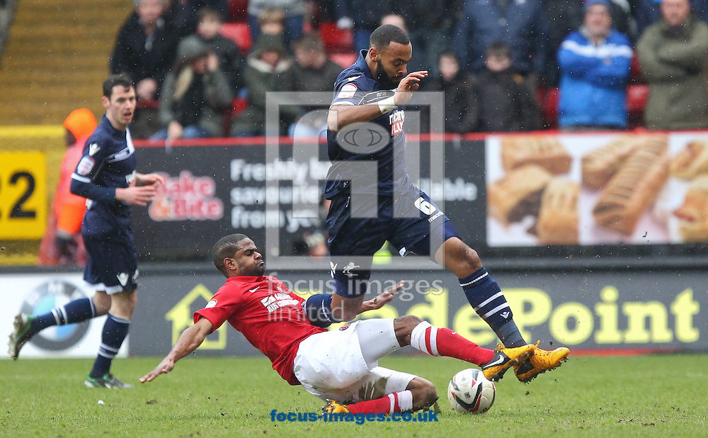 Picture by John  Rainford/Focus Images Ltd +44 7506 538356.16/03/2013.Bradley Pritchard of Charlton Athletic slides in on Liam Trotter of Millwall during the npower Championship match at The Valley, London.