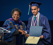 Congresswoman Shelia Jackson Lee presents commendations during the first ever graduation for Mickey Leland College Preparatory Academy, May 27, 2015.