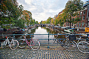 Bicyclist crossing the the Hemonybrug bridge at Keizersgracht and Leidsegracht in Amsterdam.