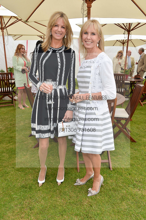 Left to right, FIONA SANGSTER and SUSAN SANGSTER at the Cartier Queen's Cup Final polo held at Guards Polo Club, Smith's Lawn, Windsor Great Park, Egham, Surrey on 15th June 2014.