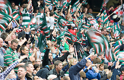 Leicester Tigers fans waving flags. The Guinness Premiership final 2010 between Leicester Tigers and Saracens at Twickenham Stadium, London, England. May 29th, 2010. .