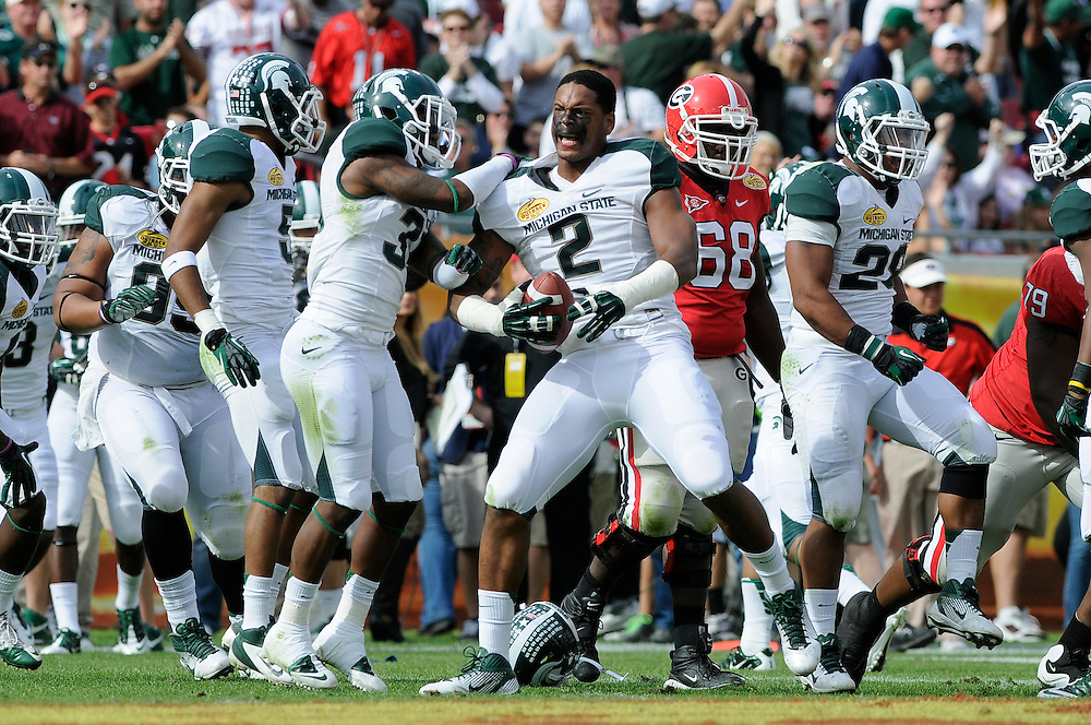 January 2, 2012: William Gholston of Michigan State is congratulated by teammates after recovering a fumble during the NCAA football game between the Michigan State Spartans and the Georgia Bulldogs at the 2012 Outback Bowl at Raymond James Stadium in Tampa, Florida.