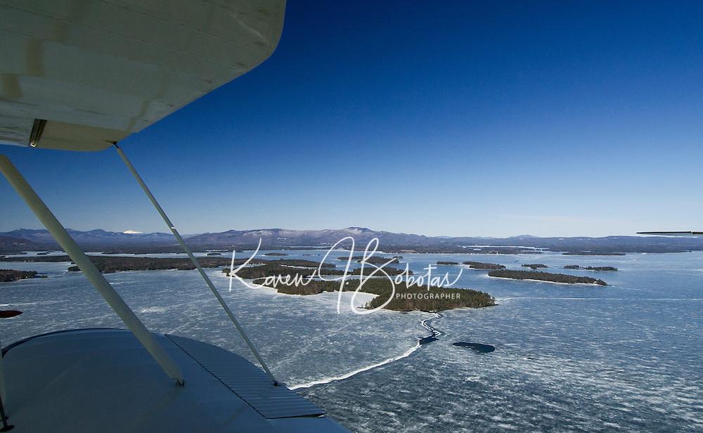 Lakes Biplane takes flight over Lake Winnipesaukee Thursday afternoon.  (Karen Bobotas Photographer)