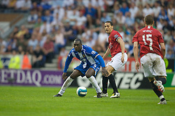 WIGAN, ENGLAND - Sunday, May 11, 2008: Manchester United's Rio Ferdinand and Wigan Athletic's Emile Heskey during the final Premiership match of the season at the JJB Stadium. (Photo by David Rawcliffe/Propaganda)