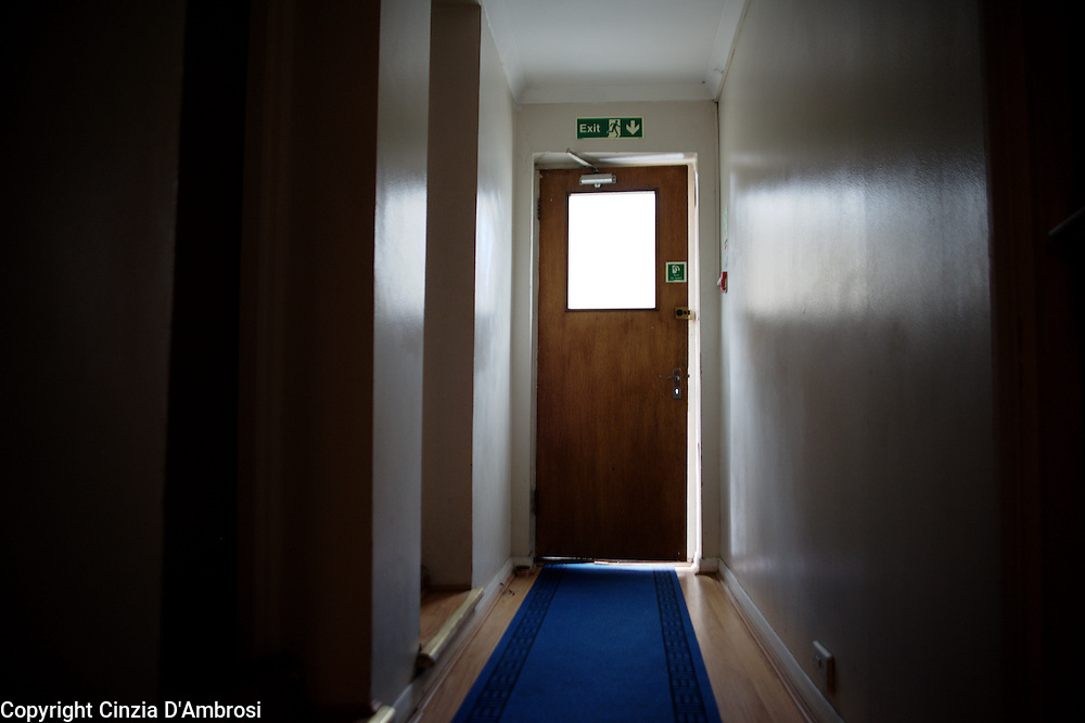 A corridor in a hotel for temporary accommodation in London. Families and individuals are placed in temporary rooms by the Hammersmith and Fulham council until a permanent home would be available for them. September, 2013.