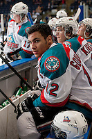 KELOWNA, CANADA - MARCH 28: Tyrell Goulbourne #12 of the Kelowna Rockets sits on the bench and stares down the Tri-City Americans' bench on March 28, 2014 during game 5 of the first round of WHL Playoffs at Prospera Place in Kelowna, British Columbia, Canada.   (Photo by Marissa Baecker/Getty Images)  *** Local Caption *** Tyrell Goulbourne;