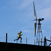 A picture of a man running near windmills on Patterson Pass near Livermore California