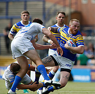 Dom Crosby (R) of Leeds Rhinos on the attack against Mourad Kriouache (L) of Toulouse Olympique during the Betfred Super 8s Qualifiers match at Emerald Headingley Stadium, Leeds<br /> Picture by Stephen Gaunt/Focus Images Ltd +447904 833202<br /> 11/08/2018