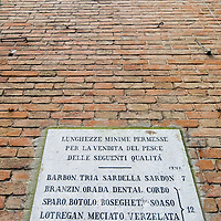 "VENICE, ITALY - FEBRUARY 08: An historic sign on the walls of Rialto Fish Market on February 8, 2011 in Venice, Italy. The Rialto Fish Market recently associated with the actor Johnny Depp because it appears in some scenes of the movie ""The Tourist"" risks closure if plans to move the fish wholesale market from Venice to Fusina go ahead."