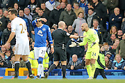Everton goalkeeper Tim Howard  argues with Referee Anthony Taylor after conceding the penalty during the Barclays Premier League match between Everton and Swansea City at Goodison Park, Liverpool, England on 24 January 2016. Photo by Simon Davies.