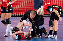 Injured Ana Gros of Krim with physiotherapist Matej Cescutti at handball match of Round 3 of Champions League between RK Krim Mercator and Hypo Niederosterreich, on November 8, 2009, in Arena Kodeljevo, Ljubljana, Slovenia.  Krim won 35:24. (Photo by Vid Ponikvar / Sportida)
