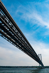 View of Forth Road bridge from below crossing the Firth of Forth in Scotland, UK