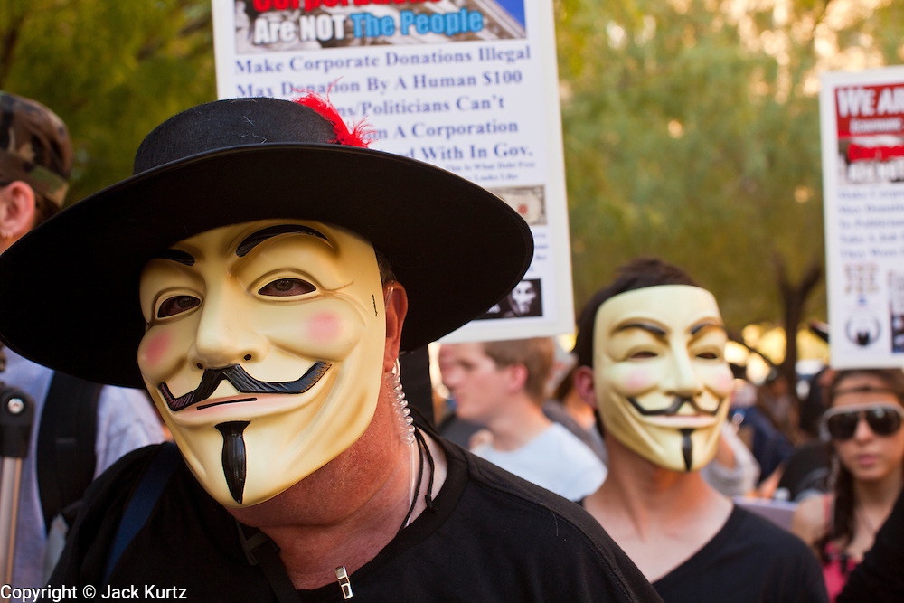 14 OCTOBER 2011 - PHOENIX, AZ:   Marchers at the Occupy Phoenix march in Phoenix, AZ. About 300 people participated in the Occupy Phoenix march through downtown Phoenix Friday evening, Oct. 14. The march was the first event in the Occupy Phoenix protests which start with the occupation of Cesar Chavez Plaza, a large square in downtown Phoenix. PHOTO BY JACK KURTZ