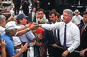 President Bill Clinton shakes hands with supporters during a campaign stop for his re-election August 28, 1996 in Royal Oak, MI