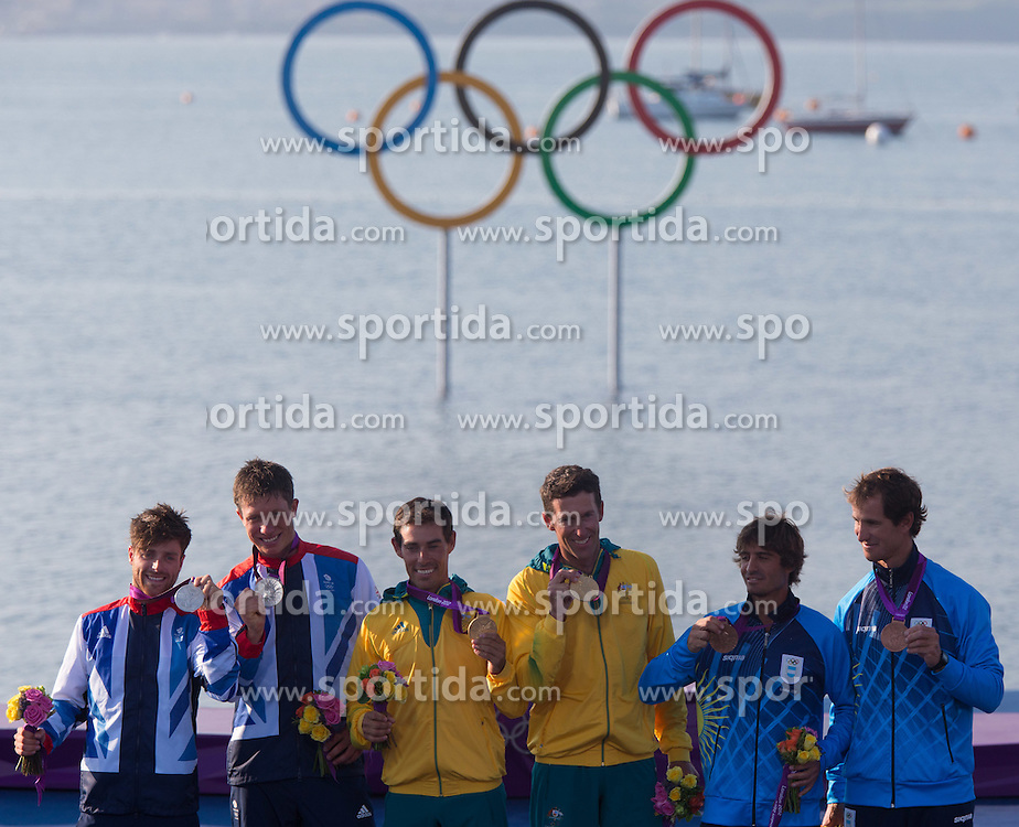 10.08.2012, Bucht von Weymouth, GBR, Olympia 2012, Segeln, Herren, 470er, Podium, im Bild Stuart Bithell, Luke Patience (GBR, silber Medaille), Mathew Belcher, Malcolm Page (AUS, Gold Medaille), Lucas Calabrese, Juan De La Fuente (ARG, bronze Medaille) // silver medal Stuart Bithell, Luke Patience (GBR), gold medal Mathew Belcher, Malcolm Page (AUS),  Lucas Calabrese, bronze medal Juan De La Fuente (ARG) during Sailing men's medal race 470er at the 2012 Summer Olympics at Bay of Weymouth, United Kingdom on 2012/08/10. EXPA Pictures © 2012, PhotoCredit: EXPA/ Johann Groder