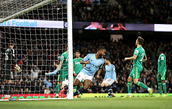 Manchester City's Raheem Sterling (centre) celebrates his sides second goal of the game during the Premier League match at the Etihad Stadium, Manchester.