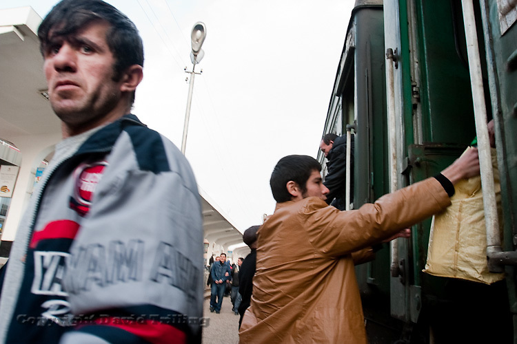 A train from Moscow arrives in Dushanbe packed with young Tajik men. The ride takes 97-hours. February 2009.