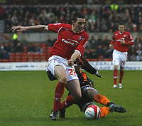 Photo: Richard Lane/Richard Lane Photography. Nottingham Forest v Blackpool. Coca Cola Championship. 13/12/2008. Kyel Reid (R) gets his tackle in against Brendan Moloney (L)