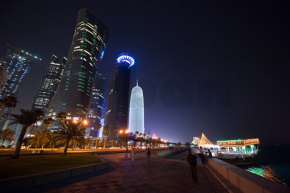 """08 APR 2013, DOHA/QATAR<br /> Palm Towers (links hinten), Al Bidda Tower (links vorne), Qatar World Trade Center (Qatar General Insurance Reinsurance Company) (2.v.R.), und Doha Tower, auch """"Condom Tower"""" (rechts), gesehen von der Al Corniche Street<br /> IMAGE: 20130408-01-043<br /> KEYWORDS: Katar, Hochaus, Wolkenkratzer, Tower, Skyscraper, Nacht, night, Nachtaufnahme, Hochhaeuser, Hochäuser, Skyscraper, West Bay, Dwontown Doha"""