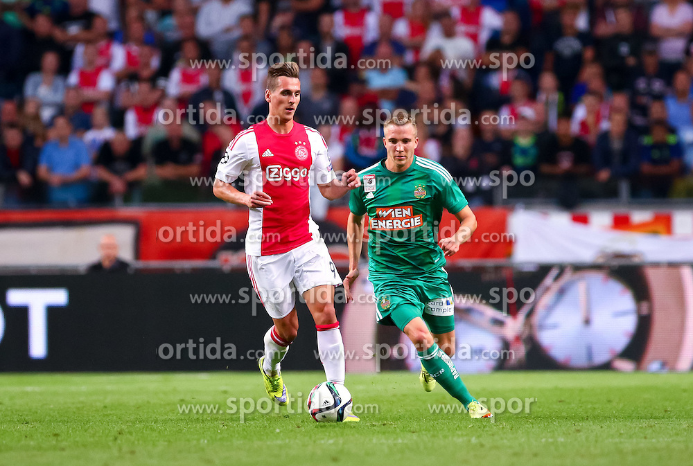 04.08.2015, Amsterdam Arena, Amsterdam, NLD, UEFA CL, Ajax Amsterdam vs SK Rapid Wien, Qualifikation, 3. Runde, Rückspiel, im Bild Arkadiusz Milik (Ajax Amsterdam), Christopher Dibon (SK Rapid Wien)// during the UEFA Champions League Qualifier 3rd round, 2nd Leg Match between Ajax Amsterdam and SK Rapid Wien at the Amsterdam Arena in Amsterdam, Netherlands on 2015/08/04. EXPA Pictures © 2015, PhotoCredit: EXPA/ Sebastian Pucher